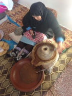 Grinding local nuts into a paste the gold old way