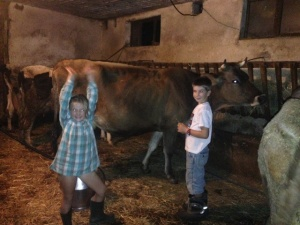 Toby & Kiki helping with milking the cows on a recent visit to the village - it was all done by hand pre 1985