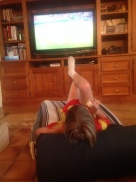 Emilio lying back with a slab of Brie watching France beat Switzerland in the World Cup